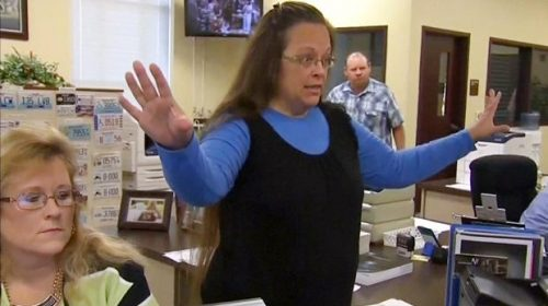 "Rowan County Clerk Kim Davis gestures as she refuses to issue marriage licenses to a same-sex couple in Morehead, Kentucky September 1, 2015, in a still image from video provided by WLEX. Davis, defying a new U.S. Supreme Court decision and citing ""God's authority,"" rejected requests for marriage licenses from same-sex couples on Tuesday in a deepening legal standoff now two months old. REUTERS/WLEX/LEX18.com  FOR EDITORIAL USE ONLY. NOT FOR SALE FOR MARKETING OR ADVERTISING CAMPAIGNS"